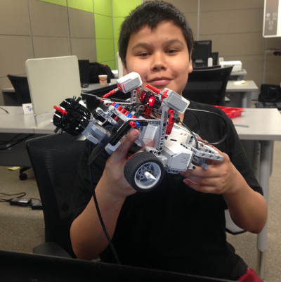 child holding an EV3 Robot